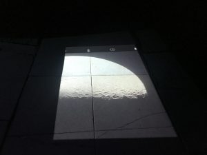 """Projection of the image of the moon as seen through my 6"""" Newtonian onto the sidewalk."""